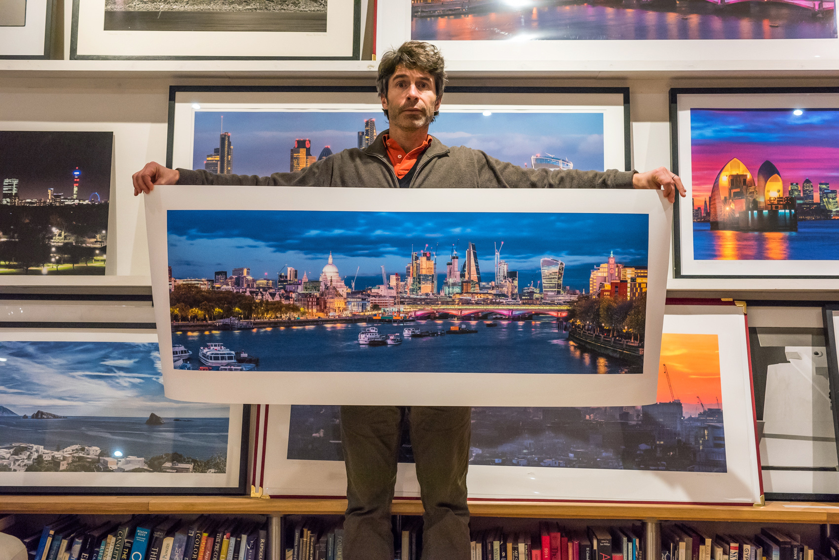 Adam holding an unframed panoramic format print of London